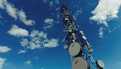 4K big tall communication tower with blue sky and clouds background Stock Footage