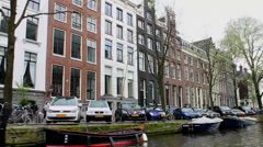 Cruising the Herengracht canal, Amsterdam Stock Footage