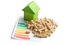 Concept of ecological and economic heating. wooden pellets. Stock Photos