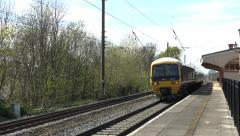 First Great Western train passing Hanwell & Elthorne station, London, UK - stock footage