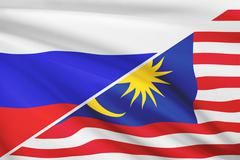 Flags of russia and malaysia blowing in the wind. part of a series. Stock Illustration