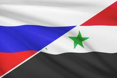 Flags of russia and syria blowing in the wind. part of a series. Stock Illustration