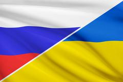 flags of russia and ukraine blowing in the wind. part of a series. - stock illustration