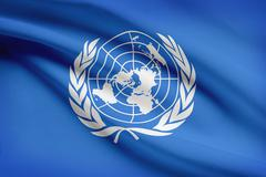 united nations (un) flag blowing in the wind. part of a series. - stock photo