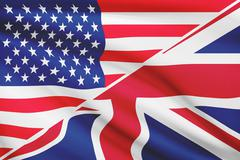 flags of usa and united kingdom blowing in the wind. part of a series. - stock photo