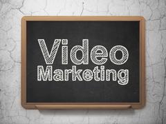 Finance concept: Video Marketing on chalkboard background Piirros