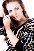 ambition and greed in fashion woman with jewelry - stock photo
