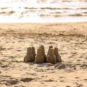 Sand castle leisure activity at the beach - stock photo