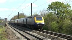 First Great Western train (w audio) passing Hanwell & Elthorne station London UK - stock footage
