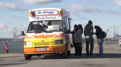 Mr whippy ice cream van people buying ice cream Stock Footage