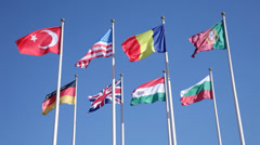 Flags of the different countries against the blue sky Stock Footage