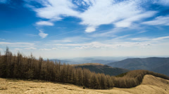 Timelapsed scenery with mountain forest, cloudy sky and valley of cities Stock Footage