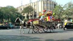 India Maharashtra District Mumbai 005  horse with wagon on a crossing - stock footage