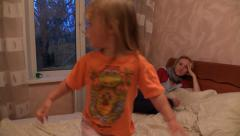 Young Girl Kidding On Bed and Falls. Slider. Stock Footage