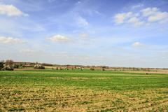 landscape in flanders fields belgium sky and clouds farm - stock photo