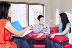 Young couple consults talking to psychologist 1 Stock Photos