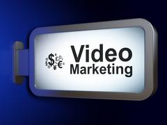 Business concept: Video Marketing and Finance Symbol on billboard background Piirros