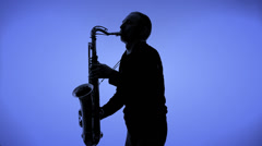 Young man playing sax in the dark Stock Footage