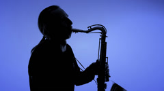 Man playing sax in silhouette. Close-up Stock Footage