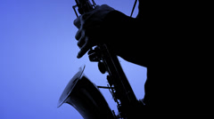 Saxophone player in a color background. Close-up Stock Footage