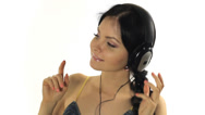 Stock Video Footage of Music. Woman dancing with headphones listening to music on mp3 player Close-up