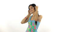 Stock Video Footage of Beautiful Woman Listening Music and dancing