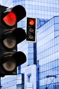 Stock Photo of traffic lights over modern business architecture