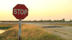 Stock Video Footage of Stop sign at airfield during sunset