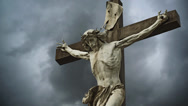 Stock Video Footage of Crucifixion. Christian cross with Jesus Christ statue.
