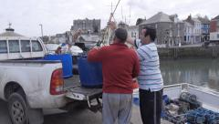 Lobster fishermen loading catch onto truck, Padstow, Cor Stock Footage