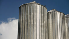 Grain Silos under Clouds time lapse footage. Agricultural background. Stock Footage