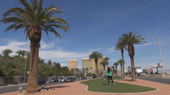 Tourist take photo entrance Las Vegas city famous sin Strip hotel casino palm US Stock Footage