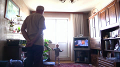 Little girl and grand father chasing and play with pet parrot at home. Stock Footage