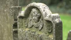 Stock Video Footage of Gravestone with Cherub (pull focus)
