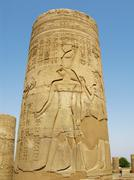temple of kom ombo, egypt: column with horus god relief - stock photo