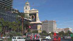 Panorama Las Vegas Strip traffic car avenue blue sky Bellagio Caesar Palace USA Stock Footage