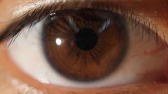 Brown eye looking at camera macro lens Stock Footage