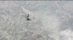 War in Afghanistan - Attack Helicopter shoots at target Stock Footage