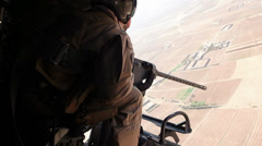 War in Afghanistan - Attack Helicopter Gunner Looking for Targets Stock Footage