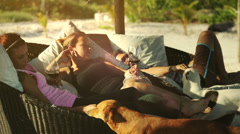 Friends at beach with dog Stock Footage