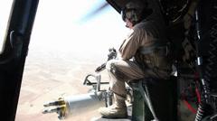 War in Afghanistan  - Helicopter door gunner scouting Stock Footage