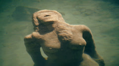Stone sculpture underwater. mystical mystic. women statue Stock Footage
