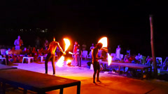 Fire show on the night party thailand-men twist fire sticks Stock Footage