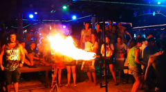 Fire show on the night party thailand-joke man passes under fire Stock Footage