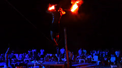 Fire show on the night party thailand-tightrope walker on the rope Stock Footage