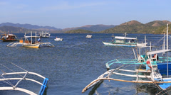 Tourist motor boats floats on the sea near the island of Coron, Philippines - stock footage