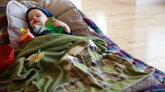 Toddler with the flu lying on a floor Stock Footage