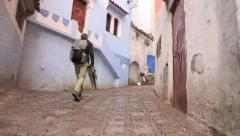 Man Walks In Chefchaouen Morocco Stock Footage