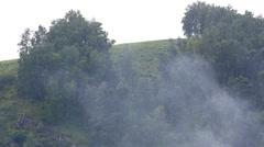Smoke on a background of rain in the mountains. altai krai. russia. Stock Footage