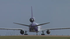 DC10/MD11 ROLLS OUT FOR TAKEOFF FROM AIRPORT Stock Footage